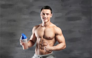 fit man with pre workout supplement